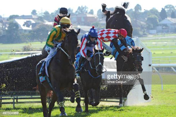 Martin Kelly riding Show Dancer crashes through the steeple jump and falls to the ground in Race 1 the Follow @ MRCTracknews on Twitter Steeplechase...