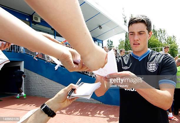 Martin Kelly signs autographs after an England training session ahead of UEFA Euro 2012 on June 8 2012 in Krakow Poland