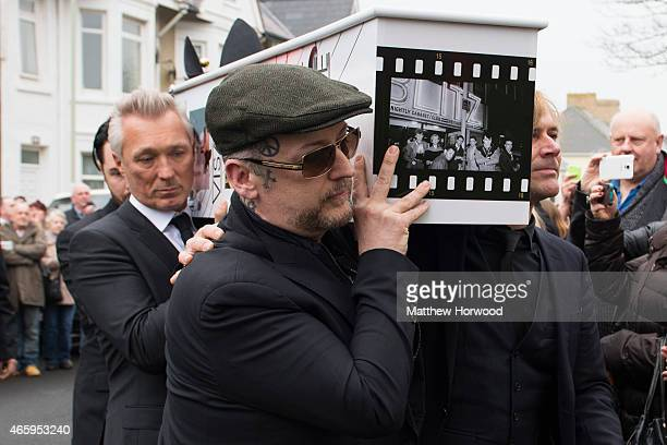 Martin Kemp and Boy George carry the coffin of Visage star Steve Strange during his funeral at All Saints Church on March 12 2015 in Porthcawl Wales...