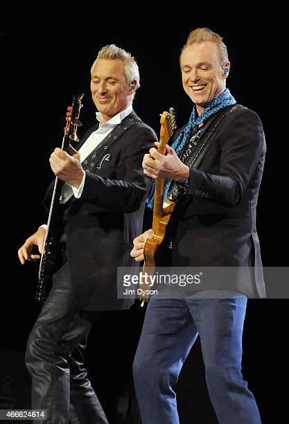Martin Kemp and Gary Kemp of Spandau Ballet perform live on stage during the Soulboys Of The Western World Tour at The O2 Arena on March 17 2015 in...