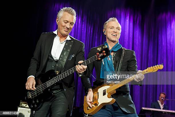 Martin Kemp and Gary Kemp of Spandau Ballet perform on stage at The O2 Arena on March 17 2015 in London United Kingdom