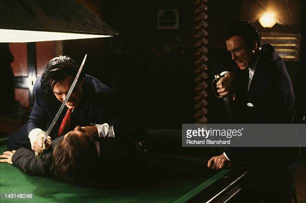 Martin Kemp and his brother Gary as British gangsters Reggie and Ronnie Kray in 'The Krays' directed by Peter Medak 1990 In this scene they are armed...