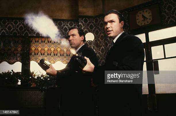 Martin Kemp and his brother Gary as British gangsters Reggie and Ronnie Kray respectively in a scene from 'The Krays' directed by Peter Medak 1990
