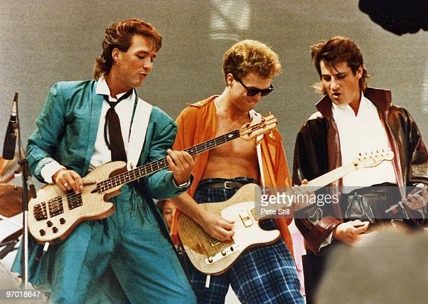 Martin Kemp, Gary Kemp and Tony Hadley of Spandau Ballet perform on stage at Live Aid, Wembley Stadium, on July 13th, 1985 in London, England.