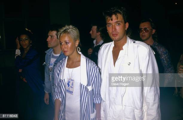 Martin Kemp of Spandau Ballet with his girlfriend Shirlie Holliman of Pepsi and Shirlie at the Live Aid concert at Wembley 13th July 1985