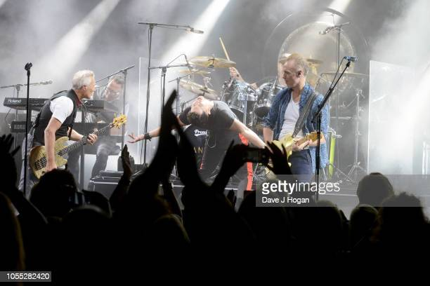 Martin Kemp, Ross William Wild and Gary Kemp of Spandau Ballet perform on stage at Eventim Apollo on October 29, 2018 in London, England.