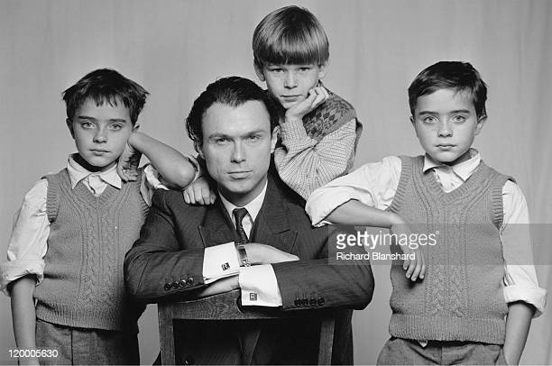 Martin Kemp who plays British gangster Reginald Kray with three of the child actors from The Krays' directed by Peter Medak 1990 At left and right...
