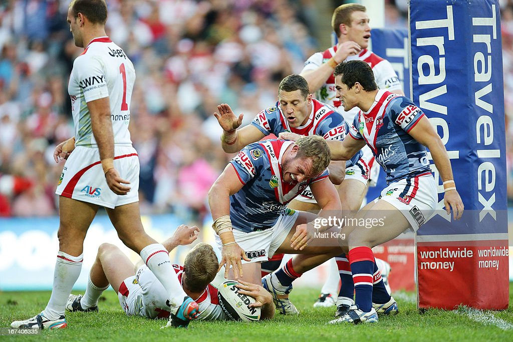 Martin Kennedy (C) of the Roosters celebrates with team mates after scoring a try during the round seven NRL match between the Sydney Roosters and the St George Illawarra Dragons at Allianz Stadium on April 25, 2013 in Sydney, Australia.