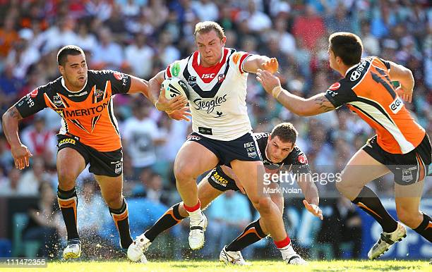 Martin Kennedy of the Roosters makes a line break to score during the round four NRL match between the Sydney Roosters and the Wests Tigers at the...