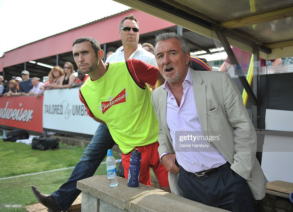 Martin Keown, David Seaman and Terry Venables, technical advisor of Wembley FC, look on during a Budweiser FA Cup Extra Preliminary Round at Vale Farm Stadium, on August 11, 2012 in Wembley, London, England.