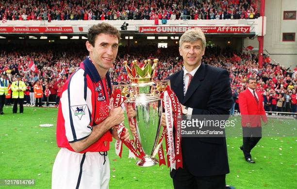 Martin Keown of Arsenal and Arsene Wenger the Arsenal Manager with the Premier League trophy after the match between Arsenal and Everton on May 11,...