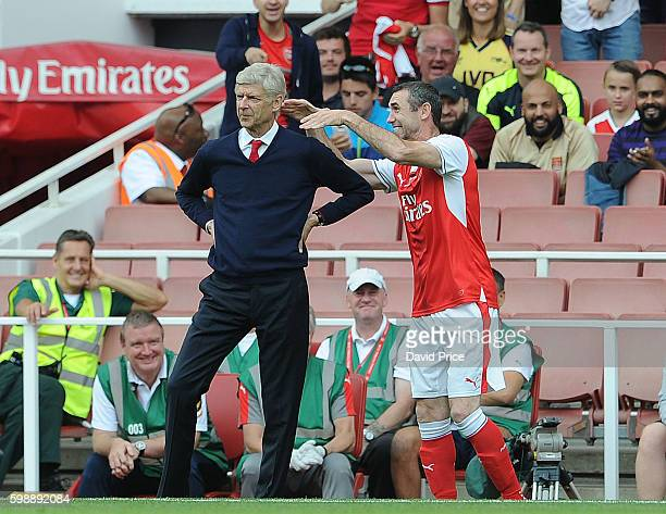 Martin Keown of Arsenal Legends pretends to strangle Arsenal Manager Arsene Wenger during the Arsenal Foundation Charity match between Arsenal...