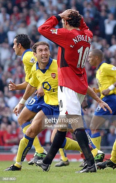 Martin Keown of Arsenal taunts Ruud Van Nistelrooy of Manchester United after a missed a penalty given away by Keown in the final minutes of their...