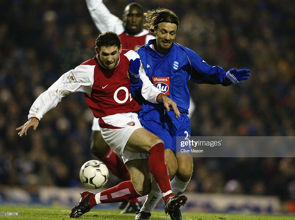 Martin Keown of Arsenal uses his strength to shield the ball from Christophe Dugarry of Birmingham City : News Photo