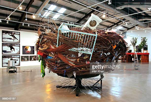 Martin Kersels creation 'Dionysian Stage' – a revolving sculpture made of willow steel aluminum tractor wheel motor found household objects– on...