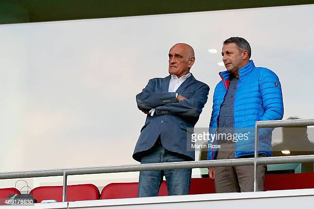 Martin Kind of Hannover 96 and Klaus Allofs of VfL Wolfsburg look on during the Bundesliga match between Hannover 96 and Hertha BSC at HDIArena on...