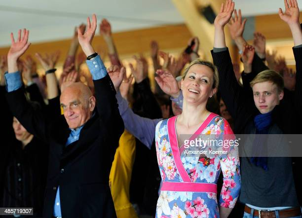 Martin Kind President of German soccer club Hannover 96 and wife of former German President Bettina Wulff cheer during a special Easter church...