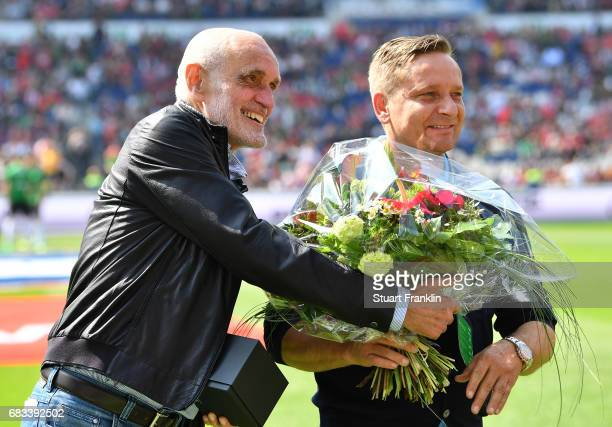 Martin Kind president of Hannover pretends to give Horst Heldt sports director of Hannover flowers before the Second Bundesliga match between...
