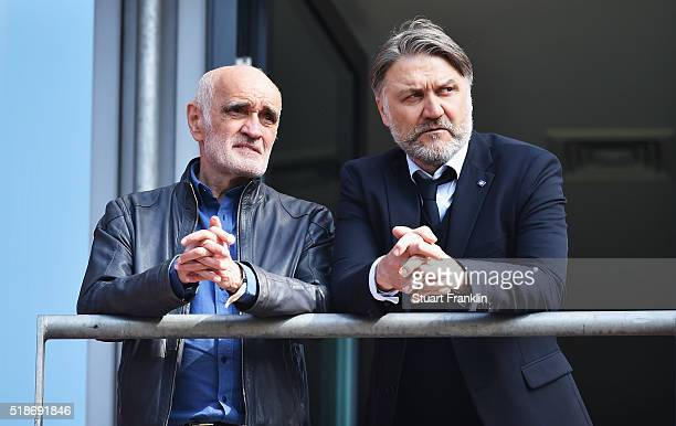 Martin Kind president of Hannover talks with Dietmar Beiersdorfer CEO of Hamburger SV during the Bundesliga match between Hannover 96 and Hamburger...