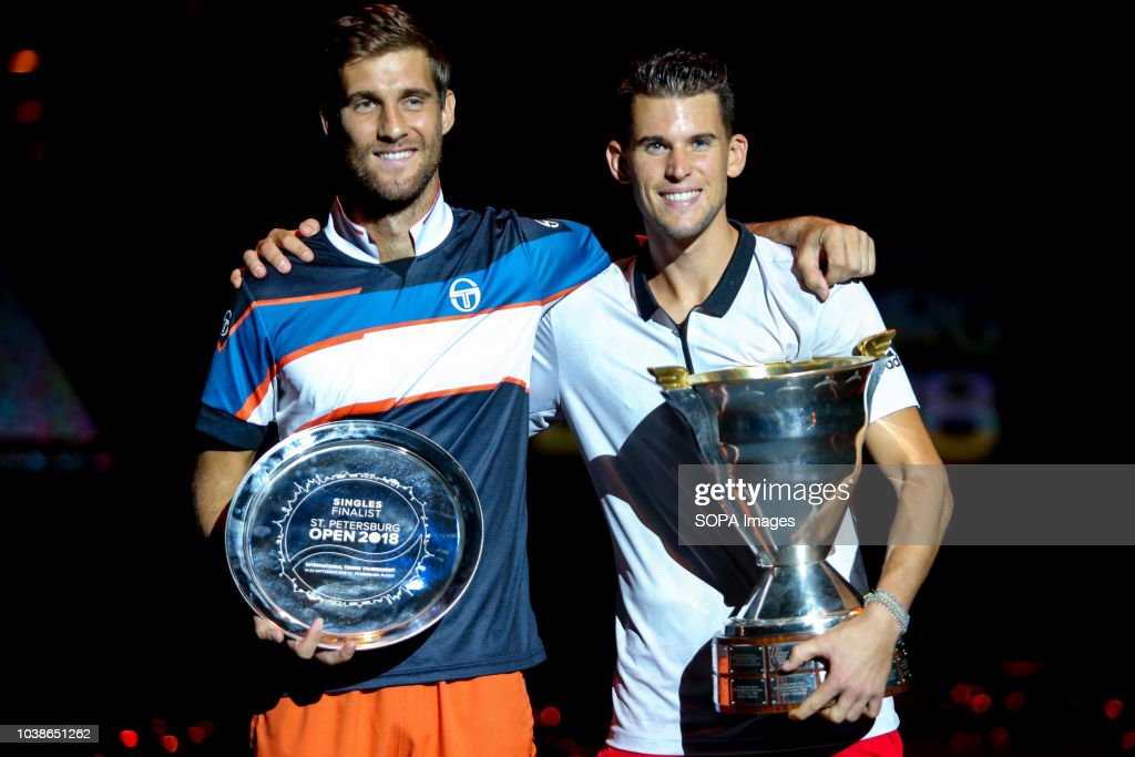 Martin Klizan of Slovakia (L) and first place Dominic Thiem... : News Photo