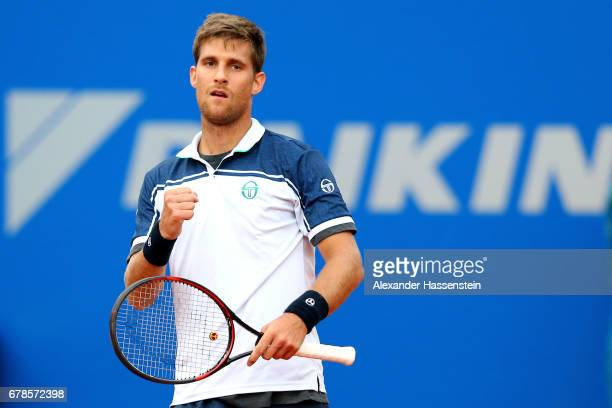 Martin Klizan of Slovakia celebrates victory after winning his 2. Round match against Mischa Zverev of Germany at the 102. BMW Open by FWU at Iphitos...