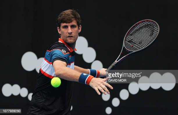 Martin Klizan of Slovakia hits a return against Alexi Popyrin of Australia during their men's first round match at the Sydney International tennis...