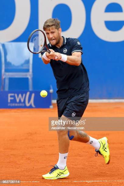 Martin Klizan of Slovakia plays a back hand during his 2nd round matach against Mirza Basic of Bosnia and Herzegovina on day 5 of the BMW Open by FWU...