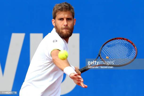 Martin Klizan of Slovakia plays a fore hand during his first round match against Ernests Gulbis of Latvia on day 4 of the BMW Open at MTTC IPHITOS on...
