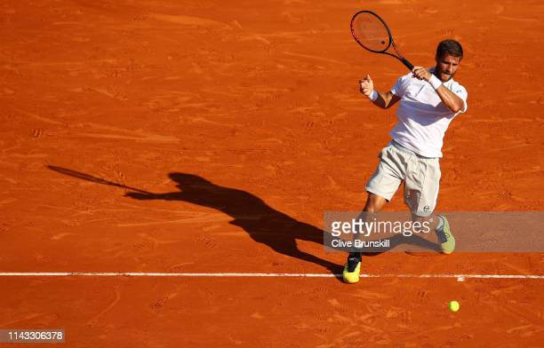 Martin Klizan of Slovakia plays a forehand against Dominic Thiem of Austria in their second round match during day four of the Rolex Monte-Carlo...