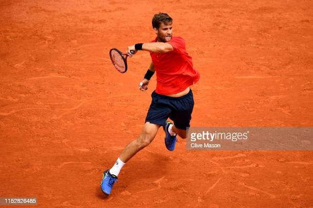 Martin Klizan of Slovakia plays a forehand during his mens singles second round match against Lucas Pouille of France during Day six of the 2019...