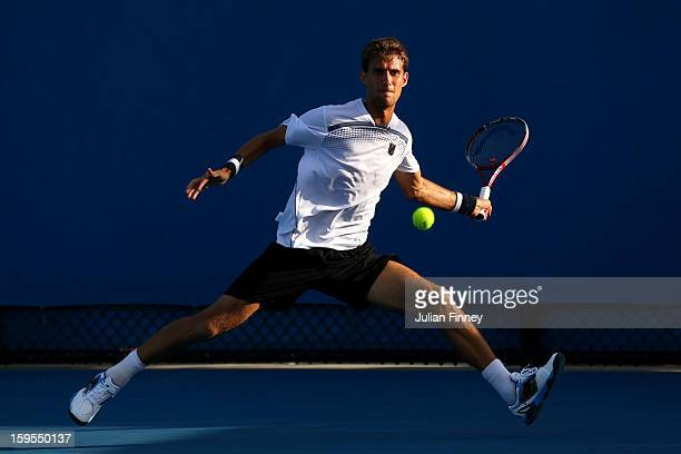 Martin Klizan of Slovakia plays a forehand in his first round match against Daniel Brands of Germany during day two of the 2013 Australian Open at...