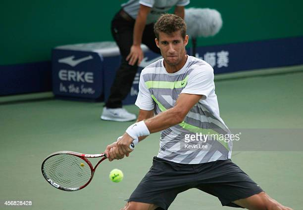 Martin Klizan of Slovakia plays backhand during his match against David Ferrer of Spain during day 4 of the Shanghai Rolex Masters at Zi Zhong...