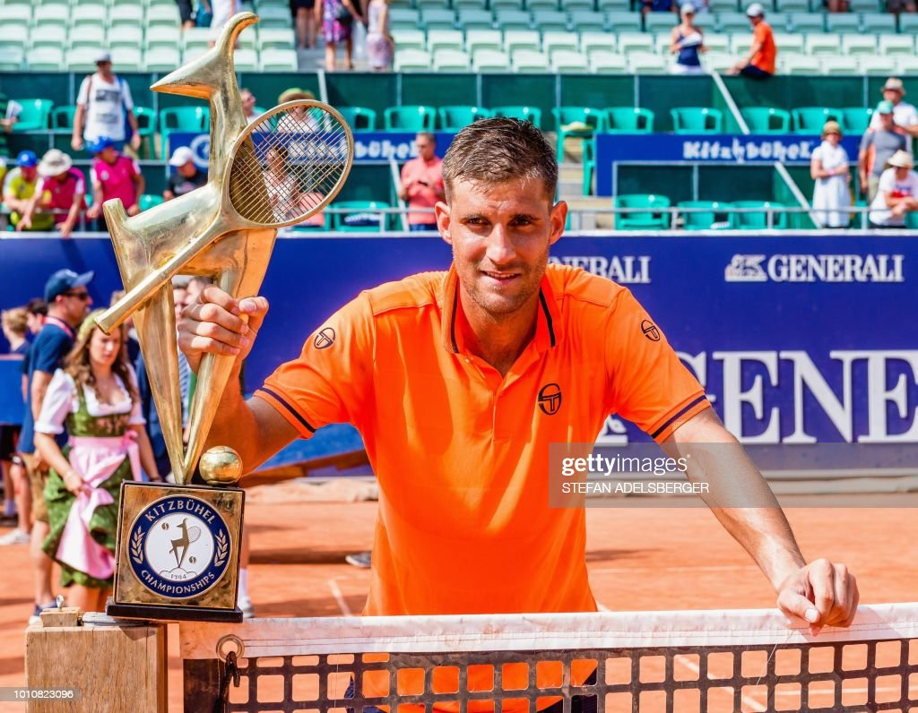 Martin Klizan of Slovakia poses with the trophy after winning the final match of the ATP Generali Open Tennis Tournament in Kitzbuehel, Austria against Uzbekistan's Denis Istomin on August 4, 2018. (Photo by Stefan ADELSBERGER / APA / AFP) / Austria OUT
