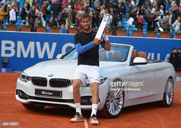 Martin Klizan of Slovakia poses with the trophy after winning the final against Fabio Fognini of Italy during the BMW Open on May 4, 2014 in Munich,...