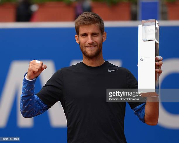 Martin Klizan of Slovakia poses with the winners trophy after the final match against Fabio Fognini of Italy during the BMW Open on May 4, 2014 in...