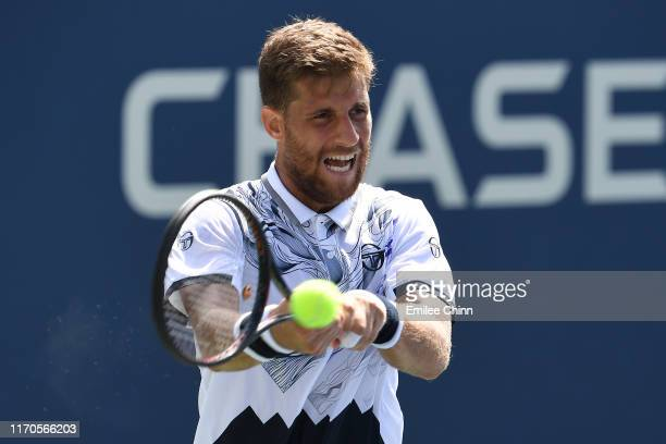 Martin Klizan of Slovakia returns a shot against Marin Cilic of Croatia during their Men's Singles first round match on day two of the 2019 US Open...