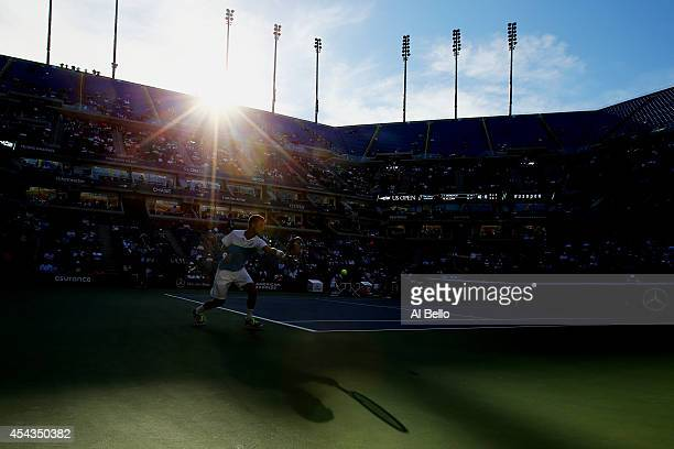Martin Klizan of Slovakia returns a shot against Tomas Berdych of the Czech Republic during their men's singles second round on Day Five of the 2014...