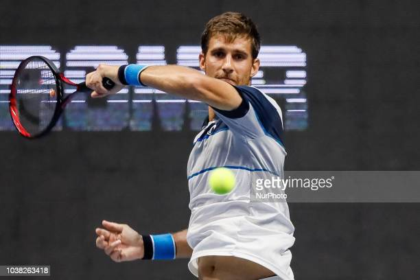 Martin Klizan of Slovakia returns the ball to Stan Wawrinka of Switzerland during their St. Petersburg Open 2018 semi final tennis match on September...