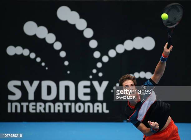 Martin Klizan of Slovakia serves against Alexi Popyrin of Australia during their men's first round match at the Sydney International tennis...