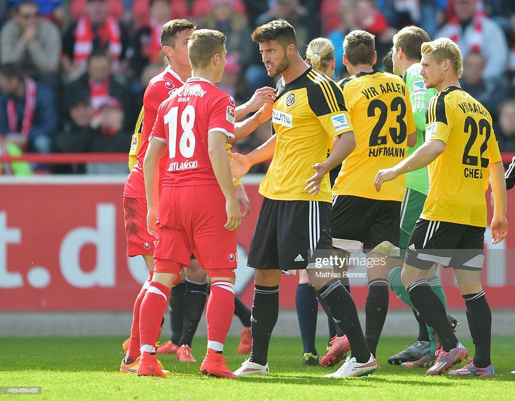 Martin Kobylanski of 1 FC Union Berlin and Jurgen Gjasula of VfR Aalen argue during the game between Union Berlin and VfR Aalen on april 12, 2015 in Berlin, Germany.