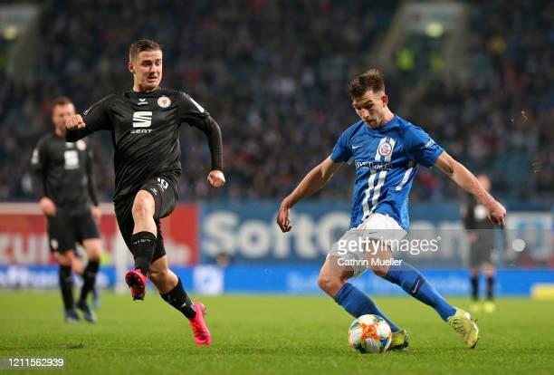 Martin Kobylanski of Eintracht Braunschweig and Daniel Patrick Hanslik of Hansa Rostock during the 3 Liga match between Hansa Rostock and Eintracht...