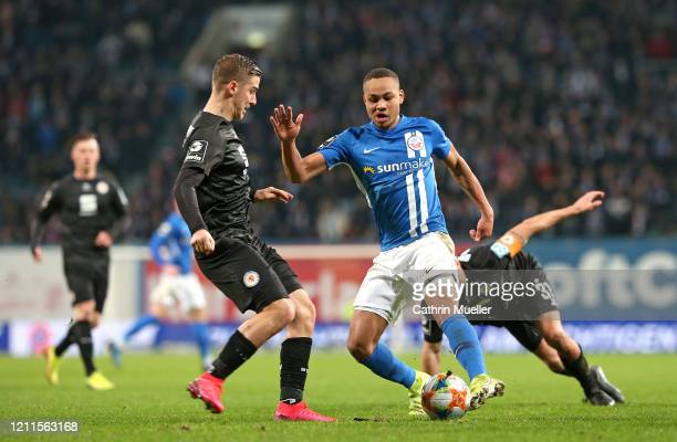 Martin Kobylanski of Eintracht Braunschweig and Nikolas Nartey of Hansa Rostock battle for the ball during the 3 Liga match between Hansa Rostock and...