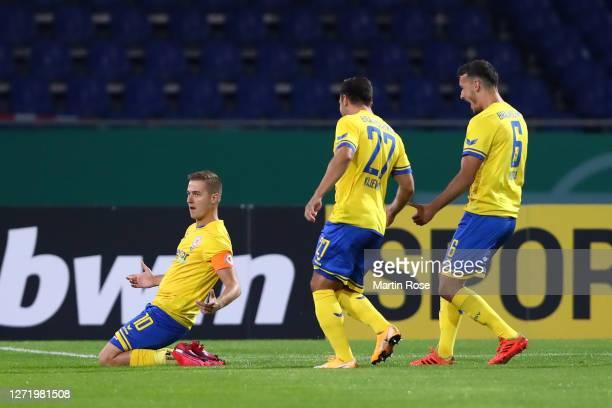 Martin Kobylanski of Eintracht Braunschweig celebrates with teammates Niko Kijewski and Dominik Wydra of Eintracht Braunschweig after scoring his...