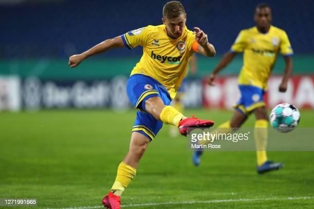 Martin Kobylanski of Eintracht Braunschweig scores his team's fourth goal during the DFB Cup first round match between Eintracht Braunschweig and...