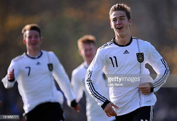 Martin Kobylanski of Germany celebrates with team mates after scoring his teams second goal during the U18 international friendly match between...