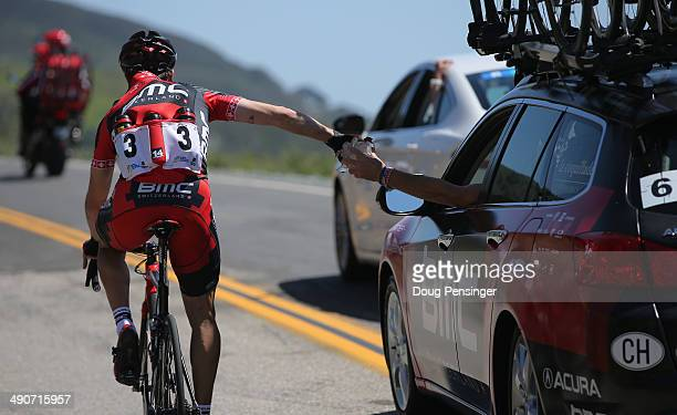 Martin Kohler of Switzerland riding for the BMC Racing Team collects ice bags from the team car on a hot ride during stage four of the 2014 Amgen...