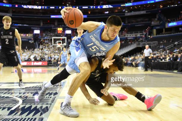 Martin Krampelj of the Creighton Bluejays fights for a loose ball with Jagan Mosely of the Georgetown Hoyas during a college basketball game at the...