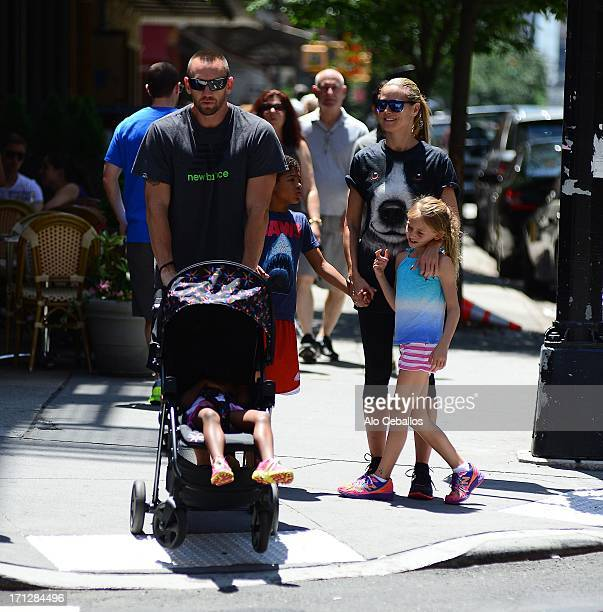 Martin Kristen, Heidi Klum, Helene Boshoven Samuel, Lou Sulola Samuel and Henry Gunther Ademola Dashtu Samuel are seen in Tribeca on June 23, 2013 in...