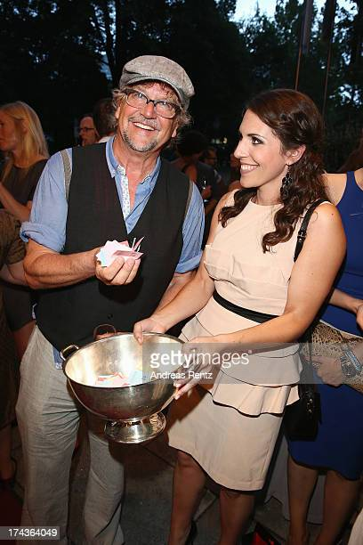 Martin Krug and Eva-Maria Reichert attend the Marcel Ostertag fashion show at Charles Hotel on July 24, 2013 in Munich, Germany.