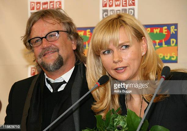 """Martin Krug and his wife, actress Veronica Ferres, attend the press conference for the project """"Safe Home-Safe Family"""" at the embassy of South Africa..."""